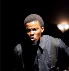 Demetrius Johnson as John Hurston
